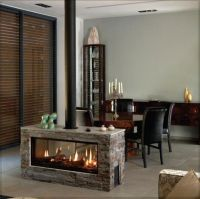 Simple fireplace in the middle of the room. | Modern ...
