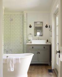 Metro tiles, sink vanity unit chest of drawers, roll top ...