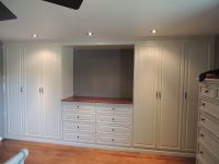 Custom white wall unit in a master bedroom   Wall Units ...