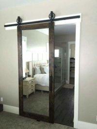 A barn door sliding mirror . . . such a great idea ...