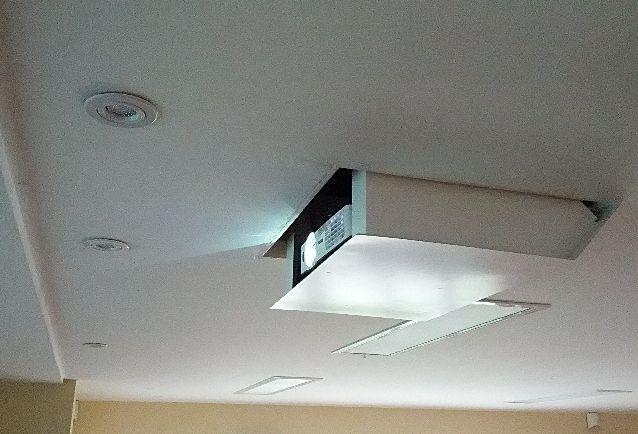 Hidden ceiling projector