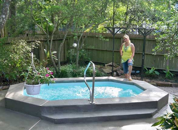 small swimming pools or large spas that look like ponds