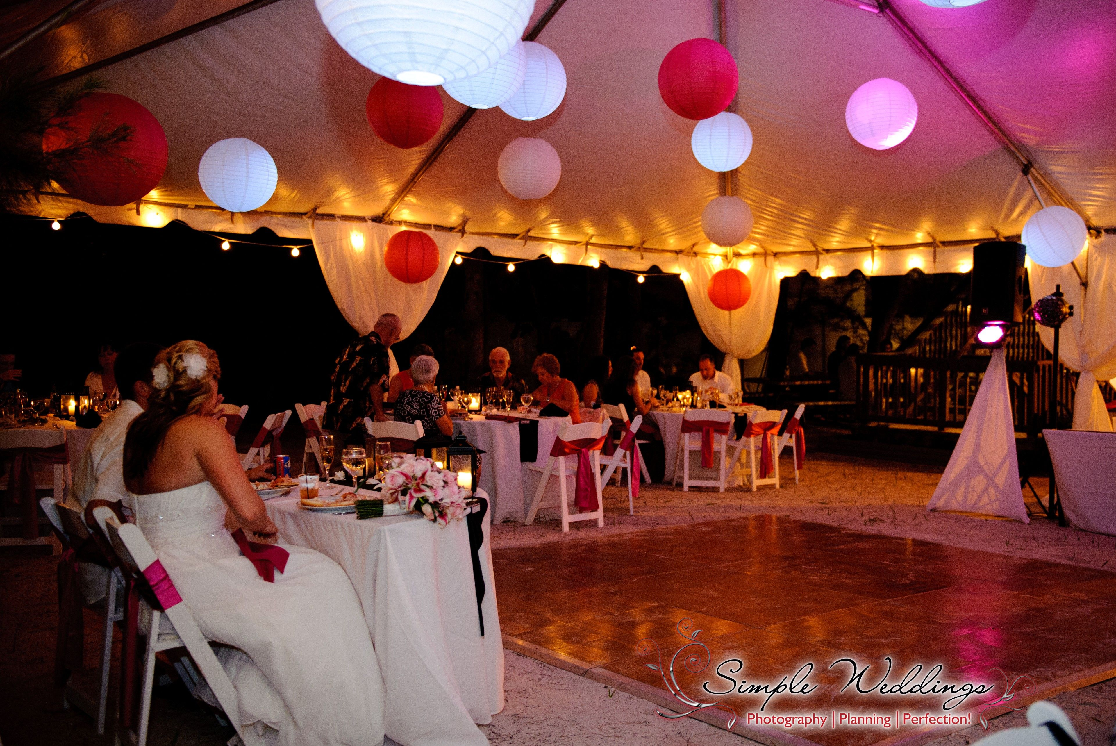 Tented Wedding Reception Behind The Sunset Beach House On Treasure