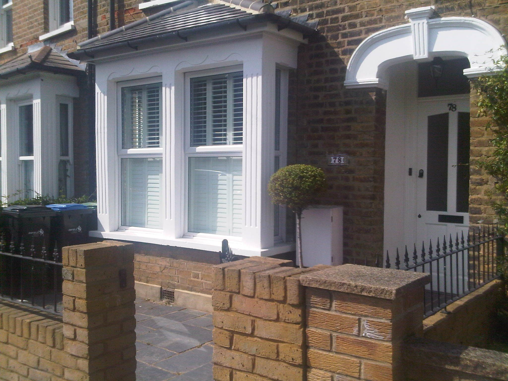 square bay window Victorian house.. Slate garden..topiary