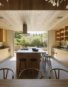 Kitchen delineated by lowered wood ceiling like color combo also wine country farmhouse bohlin cywinski jackson interiors rh pinterest