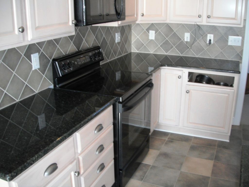 black and white tile kitchen backsplash waterworks faucets daltile granite uba tuba on cabinets with