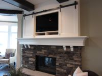 sliding doors over tv above fireplace | Fireplace ...