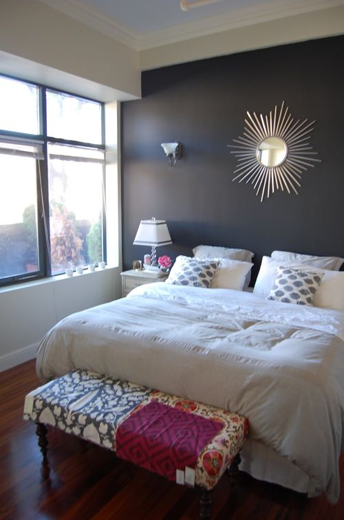 Our bedroom king sized bed white bedding gray walls