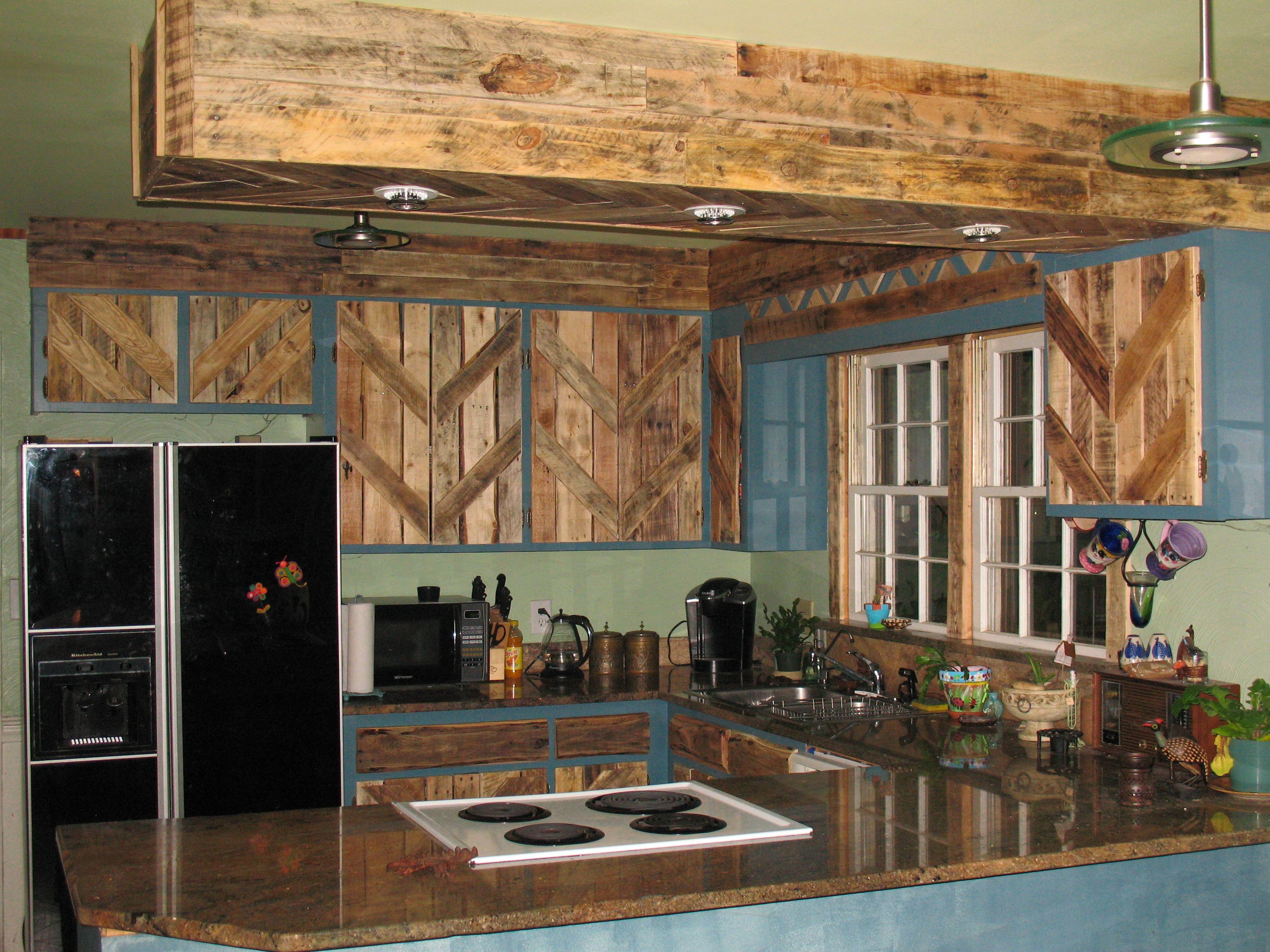 Reclaimed Kitchen Cabinets  Pallets used to reface the