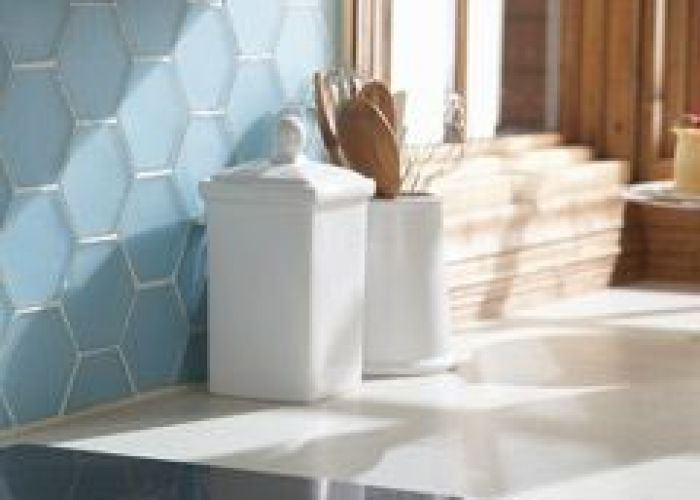 Tile go glossy glass or all white tiles serve as  dramatic focal point also