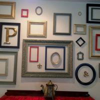 Empty frame wall art with smaller frames and objects ...
