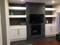 My DIY stone fireplace with built in cabinets and floating ...