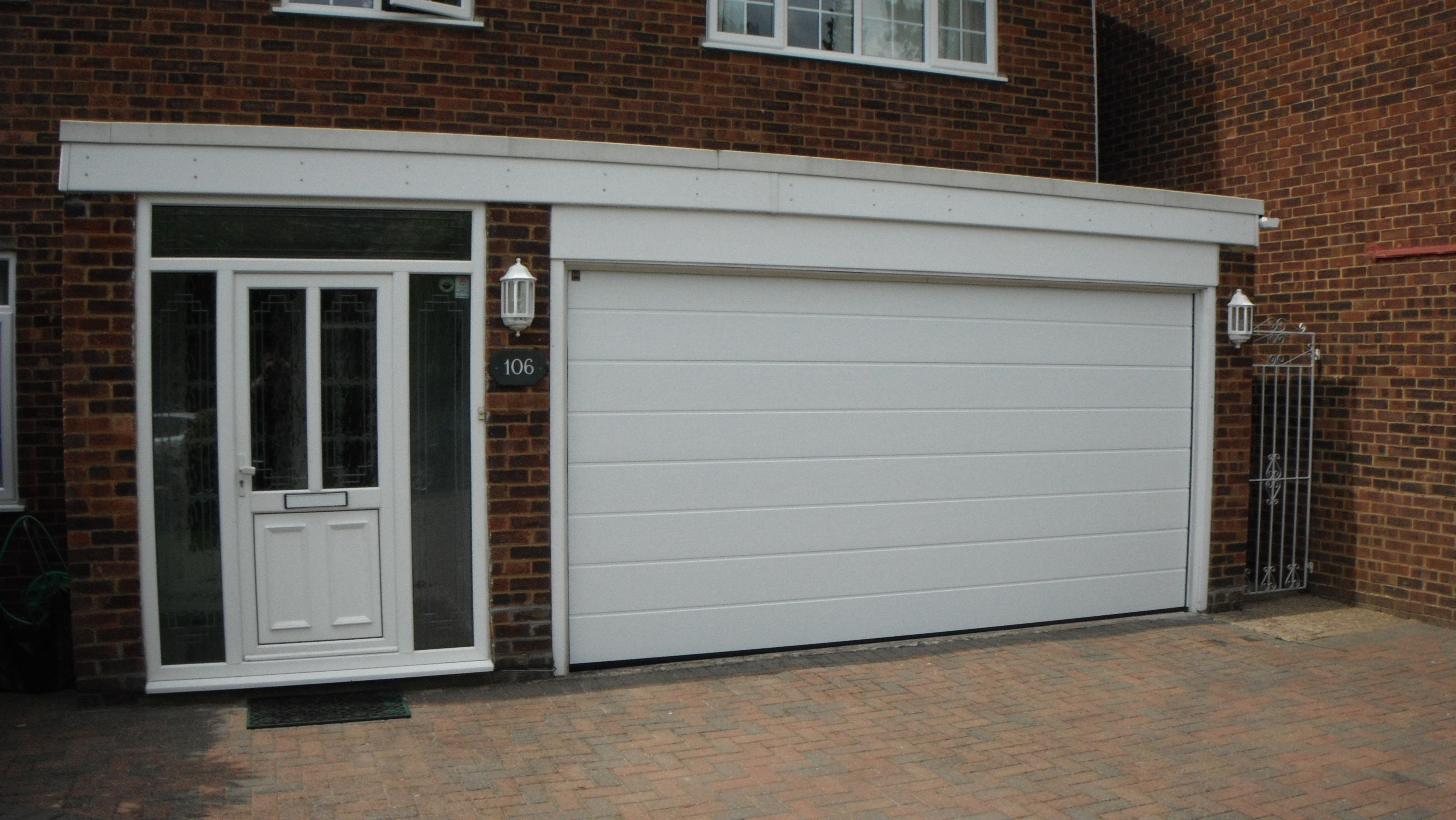 Hormann MRibbed Woodgrain White Sectional EPU40 Garage