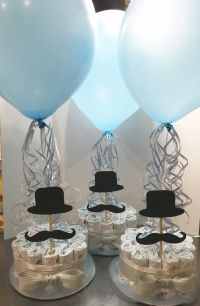 Diaper centerpieces made to order for a mustache themed ...