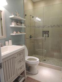 Beach theme bathroom. Stone shower, floating shelves ...