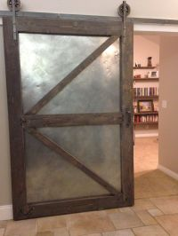 Industrial sliding barn door using aged sheet metal and ...