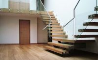 cantilevered timber stairs appear to be floating stairs ...