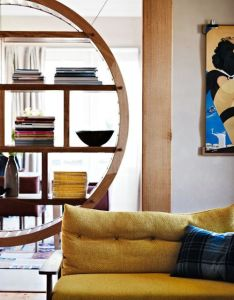 Love the round book shelf and mustard accent colored couch also her new tribe amarelo pinterest living rooms rh