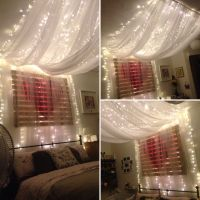 Fairy light bed canopy hung from ceiling to give effect of ...