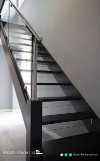 An open tread black oak staircase with steel rail & glass ...