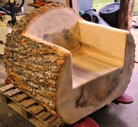 One of three log chairs that were carved out of a 36 ...