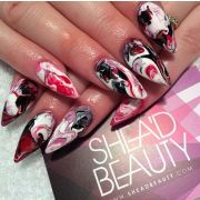 red white and black x marble nails