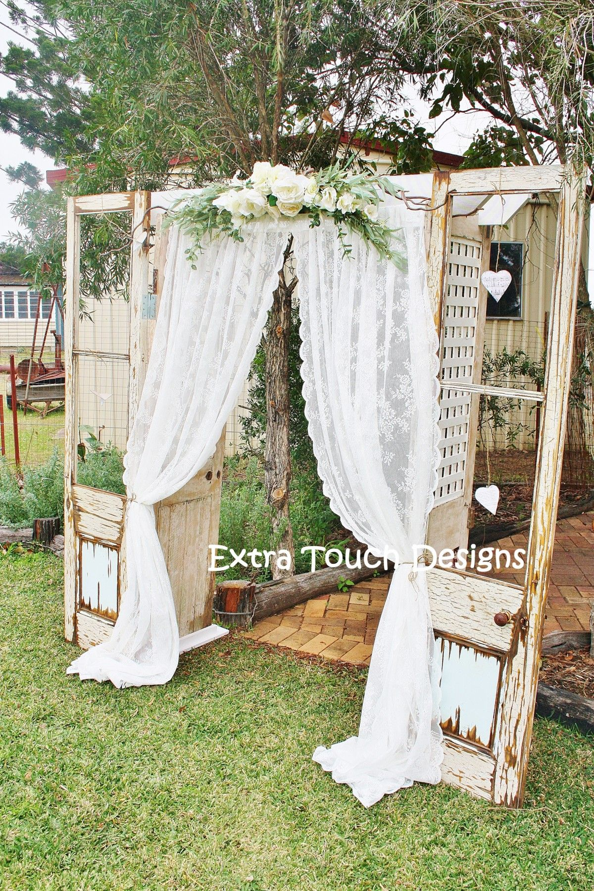 Vintage Wedding Ceremony Arch. Old doors, lace curtain