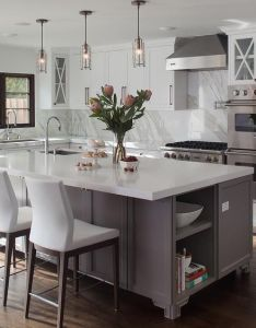 shaped kitchen features white cabinets adorned with long nickel pulls paired marble countertops and backsplash home pinterest also rh