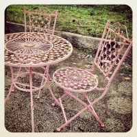 Painting all of my black wrought iron furniture.