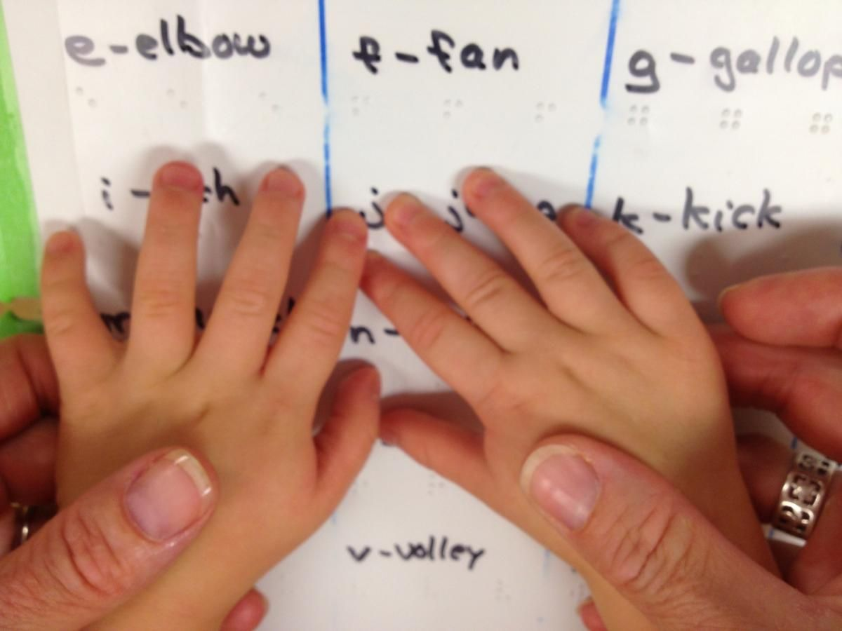 Teaching Braille To Young Children Small Hands Of Child