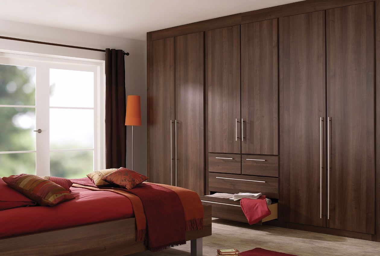 Dark brown bedroom furniture with red accessories