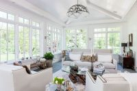 Sunroom features a vaulted ceiling, a bluestone floor with