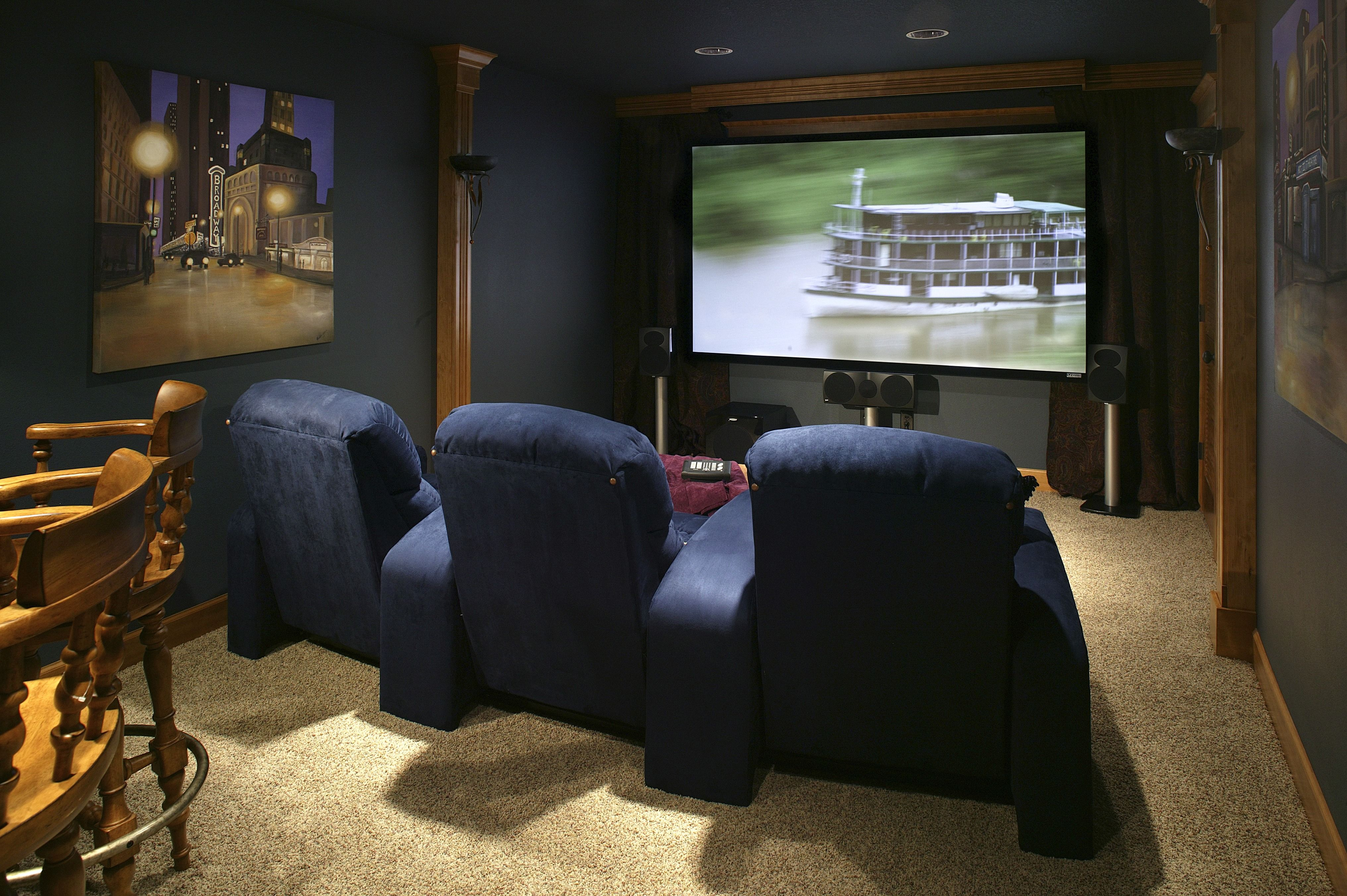 Small Home Theater Featuring A Full Bar And Three Navy