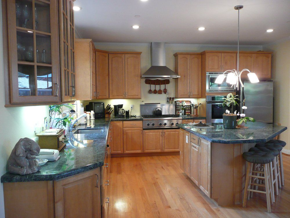 Kitchen with maple cabinets granite counter tops and red
