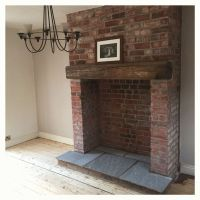 Exposed brick fireplace with indian stone hearth and ...