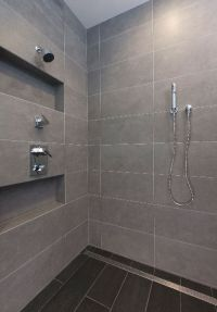 Large format tile shower and linear shower drain.Photo ...