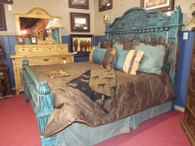Turquoise king bed with brown and turquoise accented bedding make
