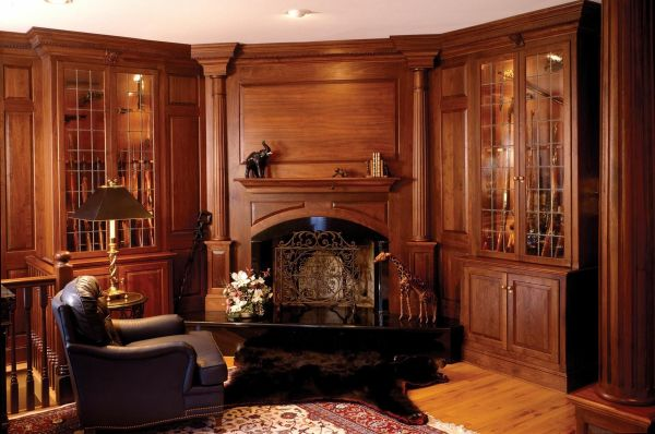 Custom Walnut Library With Fireplace And Gun Cabinets