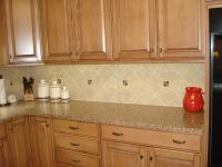 """6"""" x 6"""" field tile at a diagonal with inserts.   Kitchen ..."""