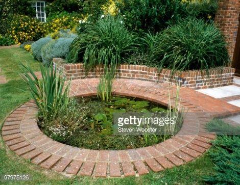 Brick Used As Edging For Circular Pond In Garden Gardens Photos