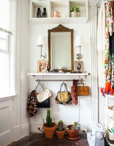 Hooks on the hanging rod below keep purses neatly organized ideas to steal from clever small space entryways diy vanity shelf also ingresso entree pinterest campaign house and interiors rh