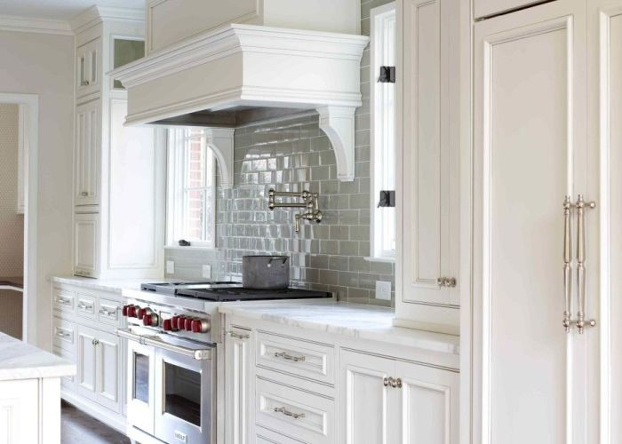 of like hardwood floor color white paneled hood with swing arm pot filler wolf stove cabinets installed over double door refrigerator subway tile also furniture wooden kitchen cabinet connected by grey