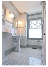 Love the grey trim with white subway tile and hex tile ...
