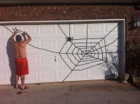 Spider web for Halloween Garage Door Use electrical tape ...
