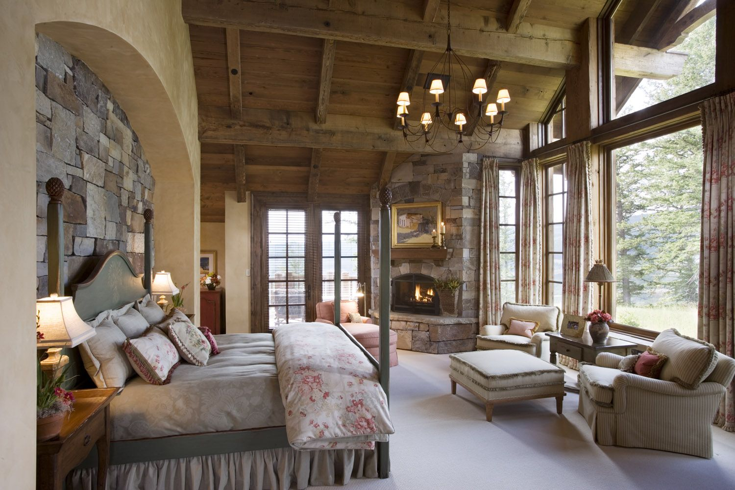 Stone wall. Mountain Lodge. Wood ceiling. Master Bedroom