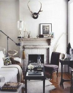 Neutral living room decor with  touch of rustic style featuring an aged wood fireplace mantle and deer antlers mounted above home also refined design decro pinterest eclectic house rh
