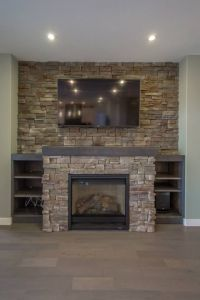 Built out fireplace with stone accent around and full ...