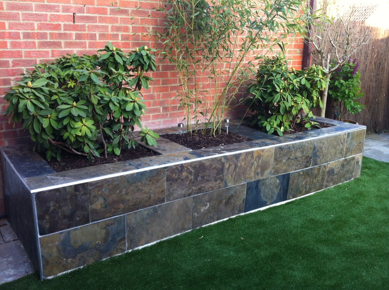 Create A Stunning Raised Flower Bed In Your Garden With Natural