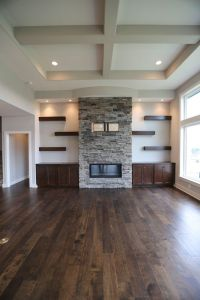 stone fireplace, gas log fireplace, floating shelves and ...
