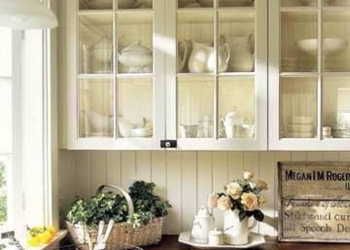 Counter tops give warmth bead board and mullion cabinet doors make it light homey farmhouse kitchen by alejandra wood countertops glass cabinets also california from country living magazine farm